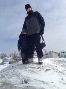 Son Simon with grandson Owen on Lake Erie ice mound near Hoak's.